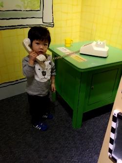 harrison talking on phone_museum